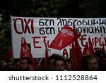 people march in central athens  ... | Shutterstock . vector #1112528864