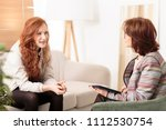 friendly therapist supporting... | Shutterstock . vector #1112530754
