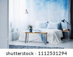 plant on wooden table in front... | Shutterstock . vector #1112531294