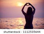 heart shape made with hands ... | Shutterstock . vector #1112535644