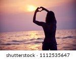 heart shape made with hands ... | Shutterstock . vector #1112535647