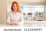 redhead woman at kitchen... | Shutterstock . vector #1112540957