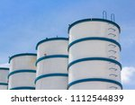 white and blue steel silos... | Shutterstock . vector #1112544839