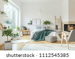 grey armchair and patterned... | Shutterstock . vector #1112545385