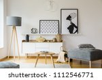 wooden table and grey pouf in... | Shutterstock . vector #1112546771