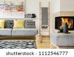 pillows on grey settee in warm... | Shutterstock . vector #1112546777