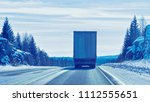 truck at the snow road in... | Shutterstock . vector #1112555651