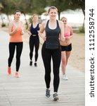 young women during racewalking... | Shutterstock . vector #1112558744