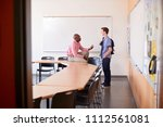 high school tutor talking with... | Shutterstock . vector #1112561081