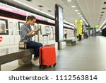 young woman with red suitcase... | Shutterstock . vector #1112563814