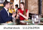 lovely couple is dining... | Shutterstock . vector #1112563904