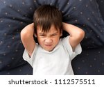 cranky child boy refuses to go... | Shutterstock . vector #1112575511