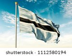 botswana flag on the blue sky... | Shutterstock . vector #1112580194