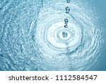 background of blue clear water... | Shutterstock . vector #1112584547