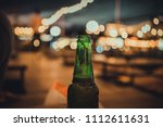 cold bottle of beer with drops... | Shutterstock . vector #1112611631