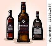 best whiskey set bottles | Shutterstock .eps vector #1112612654