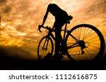 ride on bike on the road. sport ... | Shutterstock . vector #1112616875