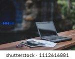 laptop on the table for start... | Shutterstock . vector #1112616881