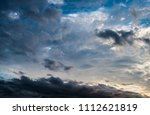 dramatic sunset sky with clouds. | Shutterstock . vector #1112621819