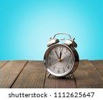 vintage alarm clocks on wooden... | Shutterstock . vector #1112625647