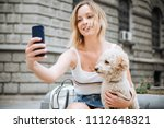young woman making selfie of... | Shutterstock . vector #1112648321
