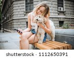 young woman with pet dog... | Shutterstock . vector #1112650391