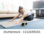 beautiful young woman sitting...   Shutterstock . vector #1112658101