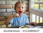 happy 5 year old caucasian boy... | Shutterstock . vector #1112684627