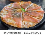 close up of salmon pizza on the ... | Shutterstock . vector #1112691971