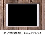white tablet computer on old... | Shutterstock . vector #1112694785