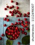 fresh cherries on wood. fresh... | Shutterstock . vector #1112698307