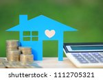 mortgage calculator  blue house ... | Shutterstock . vector #1112705321
