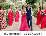 bridesmaids stand around... | Shutterstock . vector #1112713064