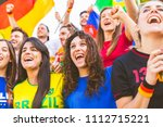 happy supporters from different ... | Shutterstock . vector #1112715221