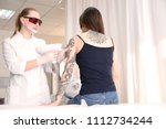 cosmetologist with patient and... | Shutterstock . vector #1112734244