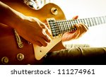 man playing electric guitar... | Shutterstock . vector #111274961