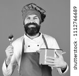 chef with red casserole and... | Shutterstock . vector #1112766689