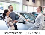 couple chatting with a salesman ... | Shutterstock . vector #111277541