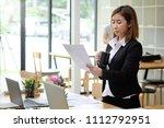 portrait shot audit asian woman ... | Shutterstock . vector #1112792951