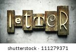 Letter concept, retro vintage letterpress type on grunge background - stock photo
