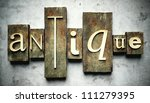 Antique concept, retro vintage letterpress type on grunge background - stock photo