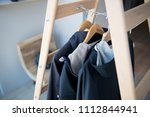 stylish shelving with shoes and ...   Shutterstock . vector #1112844941