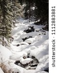 Small photo of A snow covered river near Vail, Colorado.