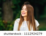 sincere smile of a girl who... | Shutterstock . vector #1112924279