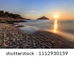 paradise beach at sunrise.... | Shutterstock . vector #1112930159