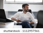 businessman reading papers... | Shutterstock . vector #1112957561