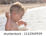 the boy is swimming in the sea. | Shutterstock . vector #1112969939