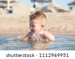 the boy is swimming in the sea. | Shutterstock . vector #1112969951