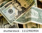 wad of dollar bills on a table | Shutterstock . vector #1112983904