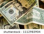 wad of dollar bills on a table   Shutterstock . vector #1112983904